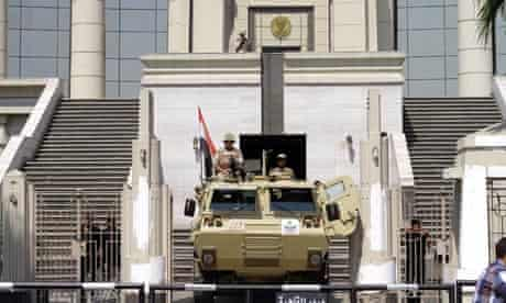 An armoured personnel carrier is stationed outside Egypt's constitutional court in Cairo
