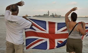 Gibraltarians wave union flags as the Royal Navy warship HMS Westminster arrives