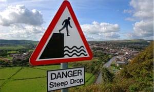 Signpost warning danger steep