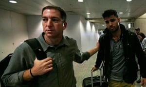 Glen Greenwald walks with his partner, David Miranda in Rio de Janeiro's international airport