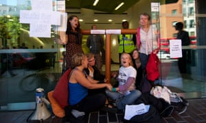 Anti-fracking and climate protesters block the entrance to the offices of PR company Bell Pottinger, who have worked with British energy firm Cuadrilla, in central London as part of the No Dash For Gas direct protest action against fracking.