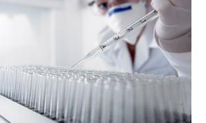 Scientist filling up test tubes