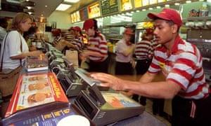 Staff serve customers at a McDonald's branch