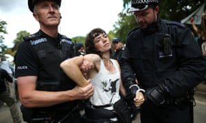 Police officers arrest anti-fracking protesters outside a drill site operated by Cuadrilla Resources Ltd in Balcombe, West Sussex.