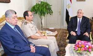 Egypt's interim deputy prime minister and defence minister, armed forces General Abdel Fatah al-Sisi (centre) and its interior minister, Mohammed Ibrahim, (left) attend a meeting with Egypt's interim President Adli Mansour.