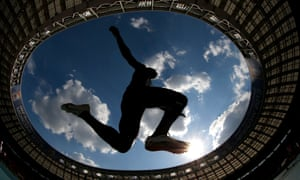 France's Gaëtan Saku Bafuanga Baya competes in the men's triple jump final at the World Athletics Championships, framed by the Luzhniki stadium in Moscow.
