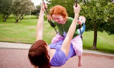 Woman and child on swing