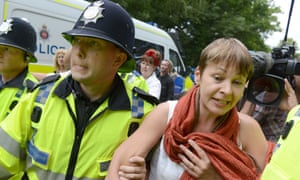 Green party MP Caroline Lucas is arrested during anti-fracking protests at the Cuadrilla site in Balcombe. Photograph: Rex Features/Tony Kershaw