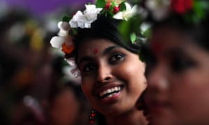 A girl wearing a flower wreath attends a political rally at Suhrawardi Udyan in Dhaka.