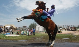 A Bedouin man rides a horse during the Sanaa Summer Festival in Yemen. The two-week long festival aims to stimulate domestic tourism and to reassure local and international tourists about Yemen's stability.