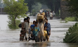 People leave flooded areas near Muridke, Pakistan. At least 108 people have been killed in different parts of the country following heavy monsoon rains. Most of the damage has been in the eastern province of Punjab, where 30 people died and about 300,000 are affected.