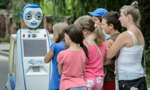 Children eye the Interactive Urban Robot, commonly called 'Jurek from Lublin' on a street in Lublin, Poland. Jurek, a research platform that serves several European universities to study the interaction between man and machine, is an intelligent robot that can perform many tasks, obtain information on how to perform a given task, and can also show various types of emotions.