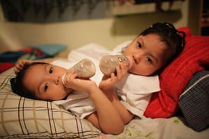 Three-year-old conjoined twins Maria and Elsa Guadalupe Sanchez (R) drink from their milk bottles at their house before heading to the kindergarten for their first day of school in Santa Catarina, on the outskirts of Monterrey. The sisters are joined by their digestive systems, livers and pelvises, according to local media. Photograph: Daniel Becerril/Reuters