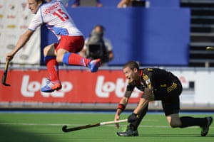 Belgium's John-John Dohmen (R) scores a goal during the field hockey match between Belgium and Czech Republic in the Men's Pool A at the European Hockey Championships 2013 at the Braxgata hockey club in Boom. Photograph: Dirk Waem/AFP/Getty Images