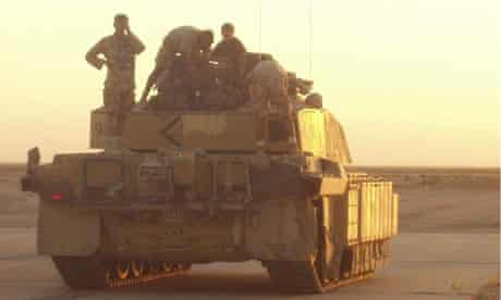 Chris Yates (left) on his tank in Afghanistan