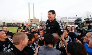 Former Argentina captain and coach Diego Maradona is lifted by players of Deportivo Riestra after they defeated San Miguel in a Primera D championship soccer match in Buenos Aires. Maradona made his debut as a part-time consultant for Deportivo Riestra, an Argentine fifth-tier team. Photograph: Marcos Brindicci/Reuters