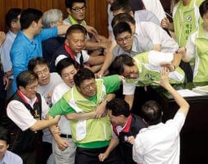 Taipei parliament fight: Legislators from the opposition DPP scuffle