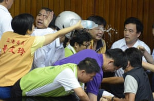 Taipei parliament fight: Huang Wen-ling (L), a legislator from th