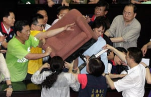 Taipei parliament fight: Legislators attempt to remove a chair