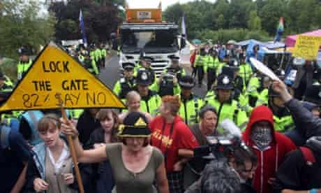 Protesters attempt to slow vehicles down that are arriving at the Balcombe fracking site in West Sussex as energy company Cuadrilla has started testing equipment ahead of exploratory oil drilling in the English countryside as anti-fracking protests at the site entered a ninth day.