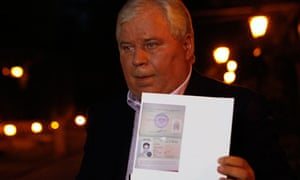 Lawyer Anatoly Kucherena shows Edward Snowden's new refugee documents granted by Russia last week.