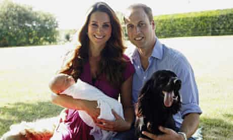 The Duchess and Duke of Cambridge with their son, Prince George, and their two dogs.