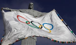 """The Olympic Flag flies in front of """"Christ the Redeemer"""" statue"""