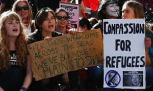 Demonstrators shout slogans against the government during a rally in support of asylum seekers in central Sydney.