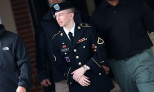 FORT MEADE, MD - AUGUST 20:  US Army Private First Class Bradley Manning is escorted out of a military court facility  during the sentencing phase of his trial August 20, 2013 in Fort Meade, Maryland. Manning was found guilty of several counts under the Espionage Act, but acquitted of the most serious charge of aiding the enemy.  (Photo by Mark Wilson/Getty Images) Crime Justice Law Politics