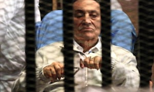 Egypt's ousted President Hosni Mubarak sits inside a dock at the police academy on the outskirts of Cairo, 15 April, 2013.