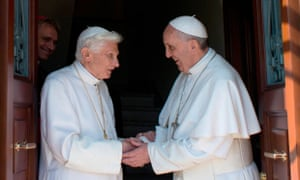 Former pope Benedict greets Pope Francis at the Vatican
