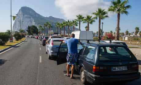 Motorists queue to cross the border between Spain and Gibraltar, 15 August.
