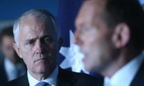 Malcolm Turnbull watches The Leader of the Opposition Tony Abbott at a press conference at St Vincents Hospital in Darlinghurst, Sydney this morning, Thursday 22nd August 2013