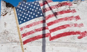 Faded Painted American Flag on a Crumbling Building, Texas.