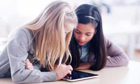 Two girls using a tablet computer