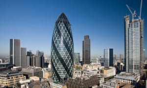 The Gherkin and the city of London with blue skies.