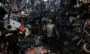 Indian boy with car parts