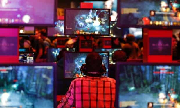 """A visitor plays """"Diablo"""" at the Blizzard exhibition stand during the Gamescom 2013 fair in Cologne, Germany."""