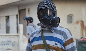 An activist wearing a gas mask in an area of Damascus where activists say chemical weapons were used