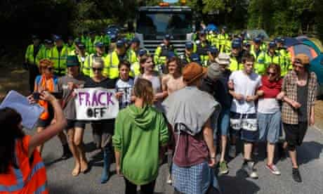 Anti-fracking protesters at Cuadrilla's site in Balcombe attempt to block the road