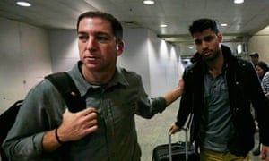 Glenn Greenwald with his partner David Miranda at Rio airport last week following Miranda's denentio