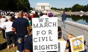 Marchers hold signs during the 50th anniversary of the 1963 March on Washington