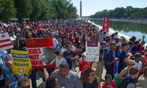 Marchers line the reflecting pool in Washington DC