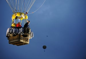 Weekend in pictures: Essey, France: Pilots in the basket of their balloon as they take part in t