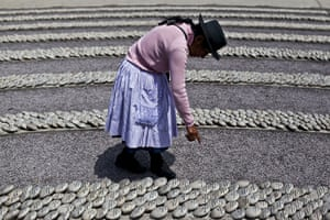 Weekend in pictures: Lima, Peru: A woman points at a stone with the name of her relative killed