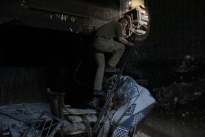 Weekend in pictures: Aleppo, Syria: A member of the Free Syrian Army climbs a ladder inside a ho