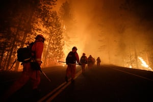 Wildfire update: Inmate firefighters walk along Highway 120