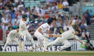 England's Alastair Cook watches Australia's Shane Watson, right, attempt to catch the ball during the fifth day of the fifth Ashes Test at the Oval.