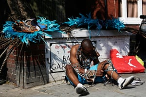 Notting Hill Carnival: A reveller puts on his costume