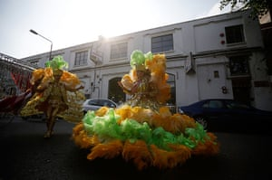 Notting Hill Carnival: Members of the Paraiso Samba troupe prepare to line up at the start